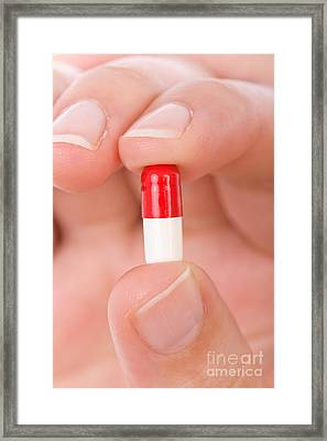 Hand Holding A Pill Framed Print by Jose Elias - Sofia Pereira