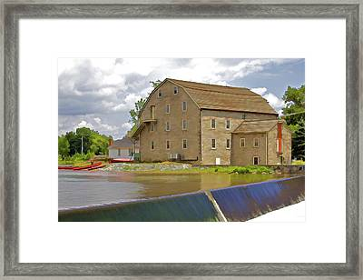 Stone Home On The Rivers Edge Framed Print