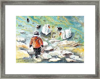 The Child And The Birds On Lake Constance Framed Print by Miki De Goodaboom