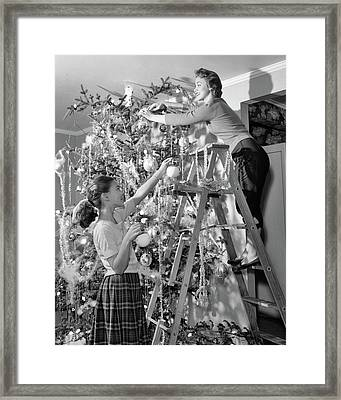 1950s Mother And Daughter Decorating Framed Print