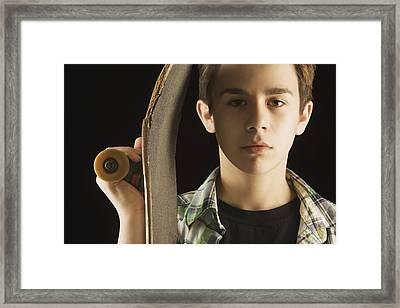 A Boy With A Skateboard Framed Print