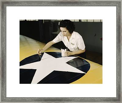 A Female Worker Paints The American Framed Print by Stocktrek Images