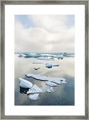A Foggy Sunset Over The Arctic Ocean Framed Print by Kevin Smith