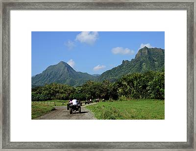 A Group Of Atv Quad Riders Take Framed Print