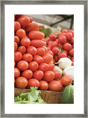 A Heap Of Plum Tomatoes In A Crate At A Market Framed Print