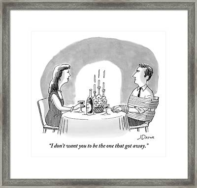 A Man And A Woman Sharing A Bottle Of Wine Framed Print