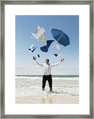 A Man Stands In The Ocean With Items Framed Print by Ben Welsh