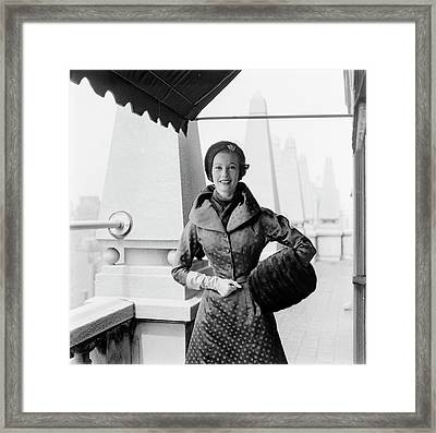 A Model Standing Against A Rooftop Column Framed Print