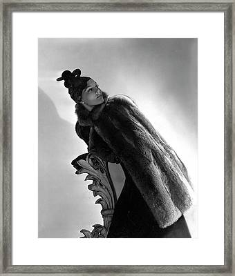 A Model Wearing A Fur Cape Framed Print by Horst P. Horst