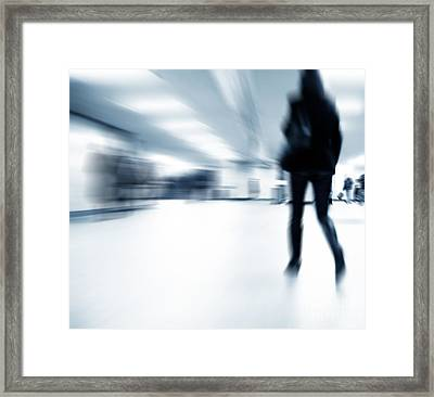 A Person Lost In The Rush Framed Print by Michal Bednarek