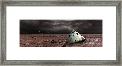 A Scorched Space Capsule Lies Abandoned Framed Print