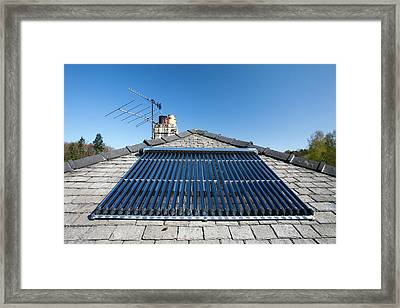 A Solar Panel Water Heater Framed Print by Ashley Cooper