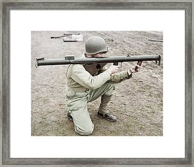 A Soldier Kneeling And Aiming Framed Print