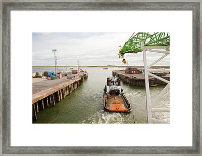 A Tug Boat Towing A Jack Up Barge Framed Print by Ashley Cooper