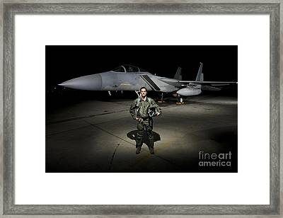 A U.s. Air Force Pilot Stands In Front Framed Print by Terry Moore