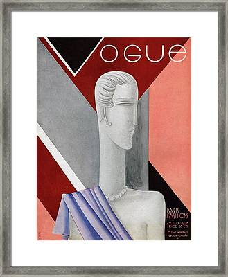A Vintage Vogue Magazine Cover Of A Mannequin Framed Print by Eduardo Garcia Benito