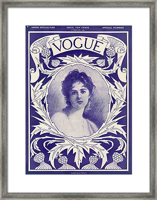 A Vintage Vogue Magazine Cover Of A Woman Framed Print by Artist Unknown
