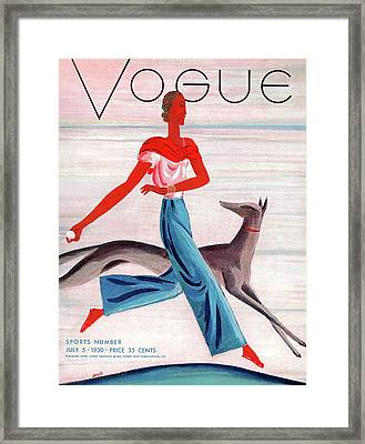 A Vintage Vogue Magazine Cover Of An African Framed Print by Eduardo Garcia Benito