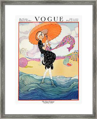 A Vogue Cover Of A Woman On A Beach Framed Print