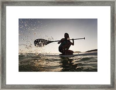 A Woman Paddling While On Her Knees On Framed Print by Ben Welsh