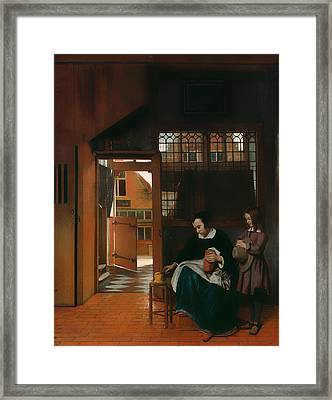 A Woman Preparing Bread And Butter For A Boy Framed Print