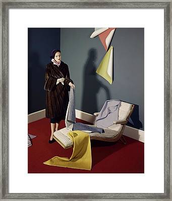 A Woman With Assorted Pieces Of Fabric Framed Print by Herbert Matter