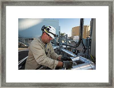 A Worker At The Ivanpah Solar Framed Print by Ashley Cooper