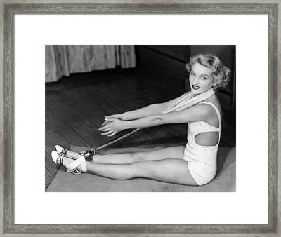 A Young Woman Exercising Framed Print