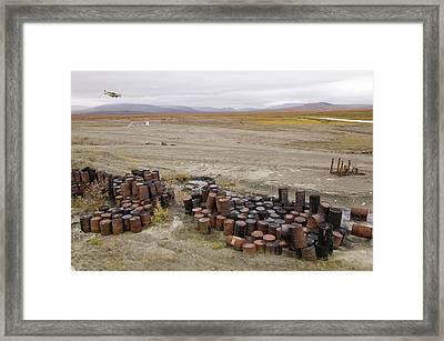 Abandoned Barrels Of Leaking Waste Oil Framed Print