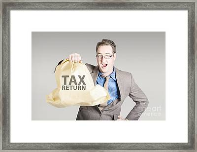 Accountant Holding Large Tax Return Refund Framed Print by Jorgo Photography - Wall Art Gallery