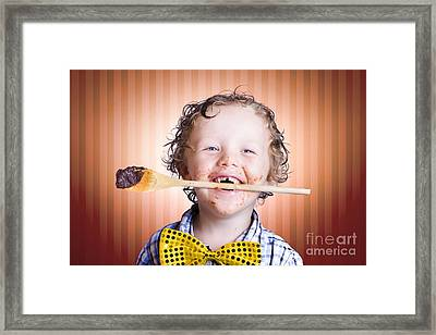 Adorable Little Boy Cooking Chocolate Easter Cake Framed Print by Jorgo Photography - Wall Art Gallery