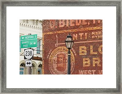 Advertisements On Side Of Building Framed Print
