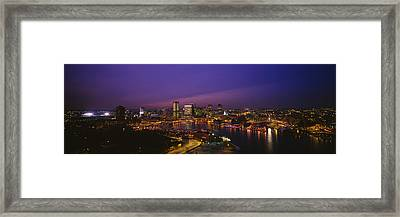 Aerial View Of A City Lit Up At Dusk Framed Print by Panoramic Images