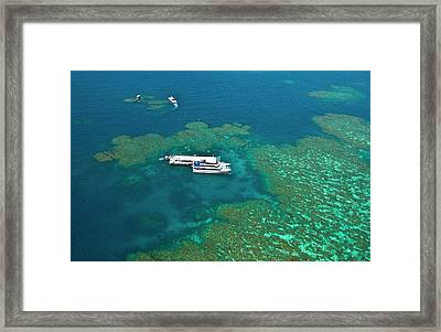 Aerial View Of A Tour Boat Docked Framed Print by Miva Stock