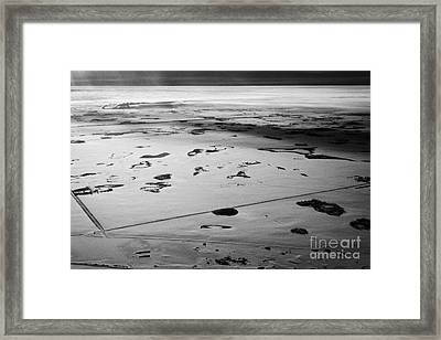 aerial view of snow covered prairies and remote isolated farmland in Saskatchewan Canada Framed Print