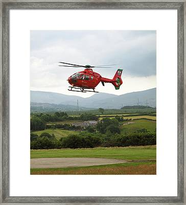 Air Ambulance Taking Off From Helipad Framed Print by Cordelia Molloy