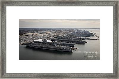 Aircraft Carriers In Port At Naval Framed Print by Stocktrek Images
