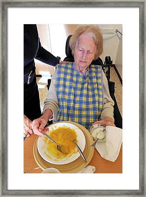 Alzheimer's Patient Being Fed Framed Print