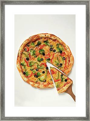 American-style Vegetable Pizza With Piece On Server Framed Print