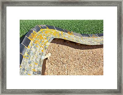 An Adobe Earth Wall Framed Print by Ashley Cooper
