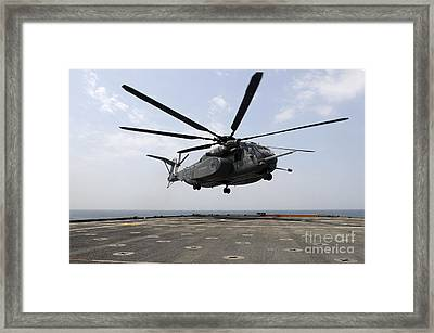 An Mh-53e Sea Dragon Prepares To Land Framed Print by Stocktrek Images