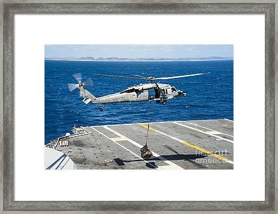 An Mh-60s Sea Hawk Delivers Supplies Framed Print