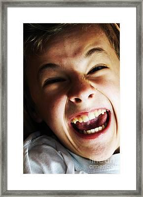 Angry Boy Portrait Framed Print by Michal Bednarek