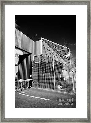 anti rpg cage surrounding observation sanger at North Queen Street PSNI police station Belfast North Framed Print