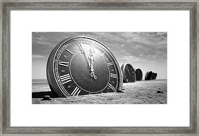 Antique Clocks In The Desert Sand Framed Print