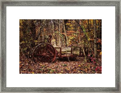Antique Manure Spreader In The Forest. Framed Print by Jeff Sinon