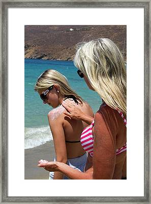 Applying Sun Cream Framed Print