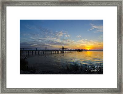 Sunset Over The Charleston Waters Framed Print by Dale Powell