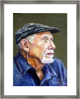 Artist In Cap Framed Print by Renuka Pillai