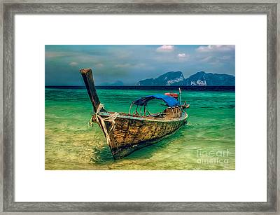 Asian Longboat Framed Print by Adrian Evans